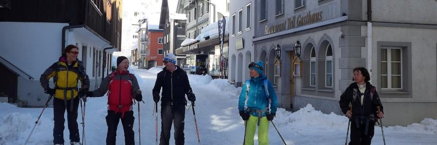 Skiers enjoying Andermatt's picturesque town centre